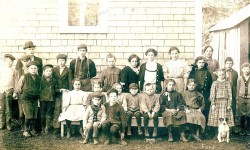 Oysterville School 1911 - Medora sits on bench at far right.